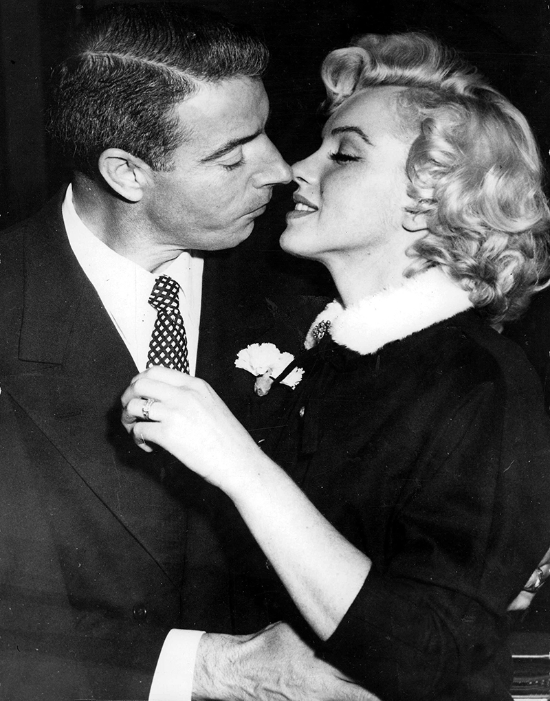 T,V, and Films, 16th January 1954, San Francisco, USA, Legendary Hollywood Film actress Marilyn Monroe prepares to kiss her husband former US Baseball player Joe DiMaggio after their wedding (Photo by Popperfoto/Getty Images)