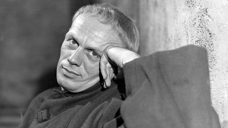 Actor Richard Widmark during a break in filming at Shepperton Studios. He is playing the role of the Dauphin in an adaptation of George Bernard Shaw's 'Saint Joan'. The film is being produced by Otto Preminger and Jean Seberg is playing the part of Joan. (Photo by Keystone/Getty Images)