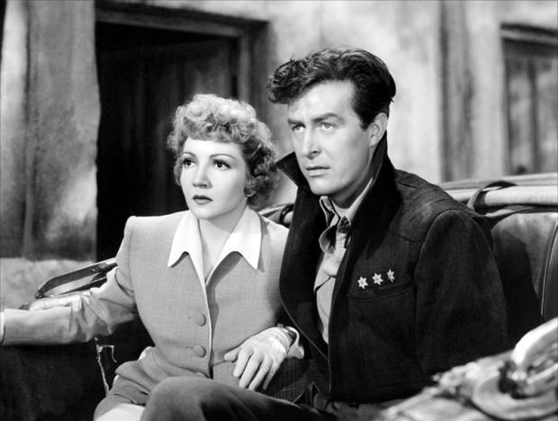 Claudette Colbert et Ray Milland dans Arise, my Love (1940) ; dans le climat de guerre, Hollywood se mit « à promouvoir» le travail des femmes mariées.
