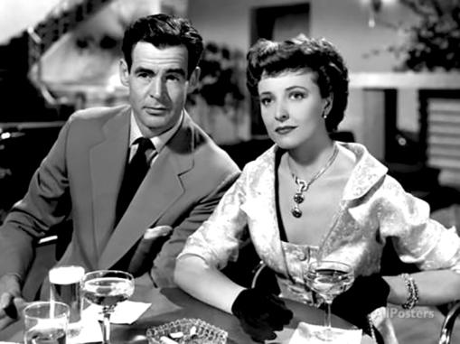 Scène de I Married a Communist (1950) de Robert Stevenson Le prospère Brad Collins (Robert Ryan, à droite) a adhéré autrefois au parti communiste qui veut désormais le récupérer. Il tente ici de protéger sa nouvelle épouse Nan (Laraine Day) et lui-même de Bailey (William Talman).