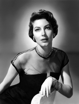circa 1950: Studio portrait of American actor Ava Gardner (1922 - 1990) wearing a black dress with a net bodice and diamond jewelry.