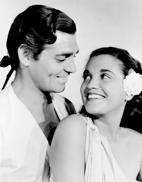 Clark Gable et Movita dans MUTINY ON THE BOUNTY réalisé par Frank Lloyd en 1935. Production : Metro-Goldwyn-Mayer
